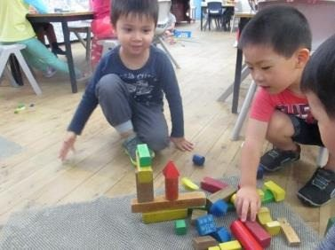 working-as-a-team-to-build-a-house-with-blocks