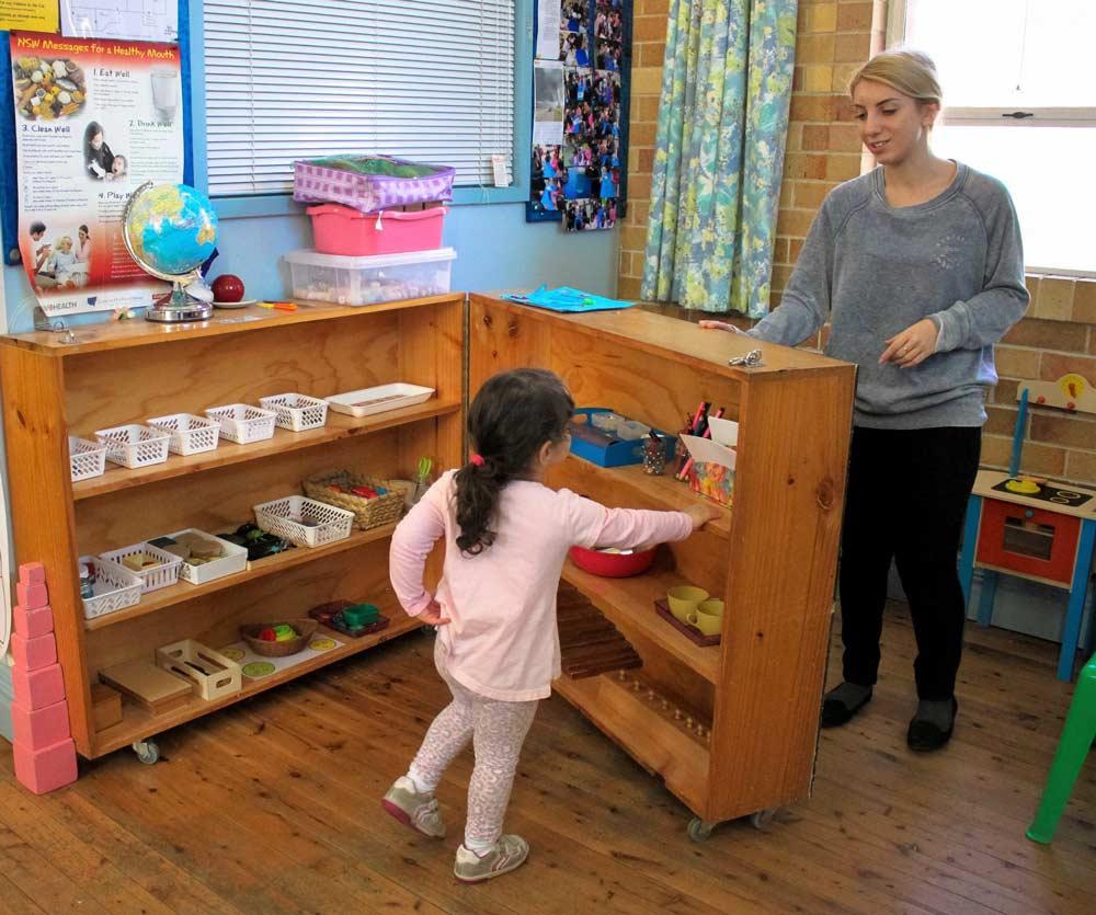 Beverly Montessori child and teacher