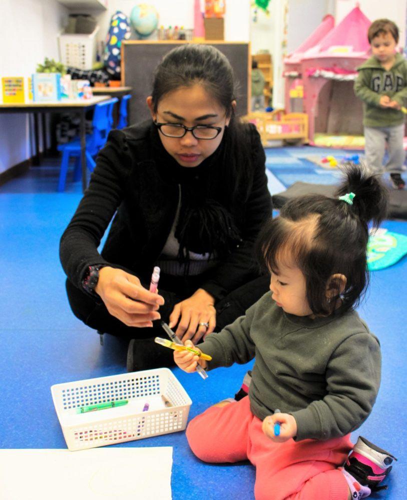 Beverly Montessori teacher and child