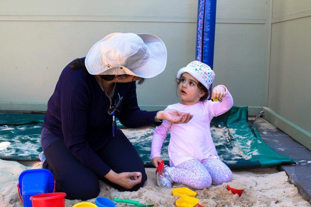 Beverly Montessori child playing in sandbox
