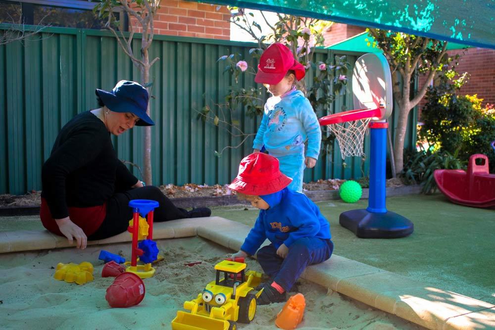 Beverly Montessori children in a sandbox