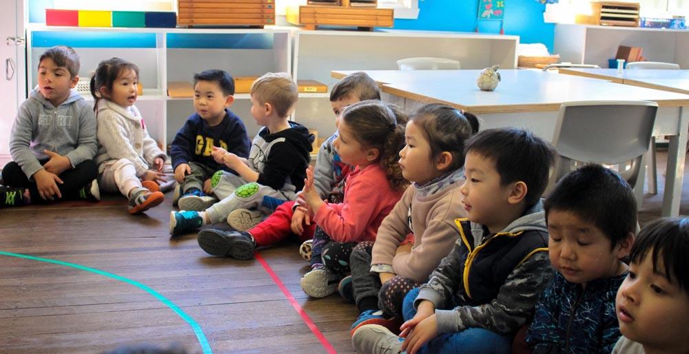 Beverly Montessori children sitting in class