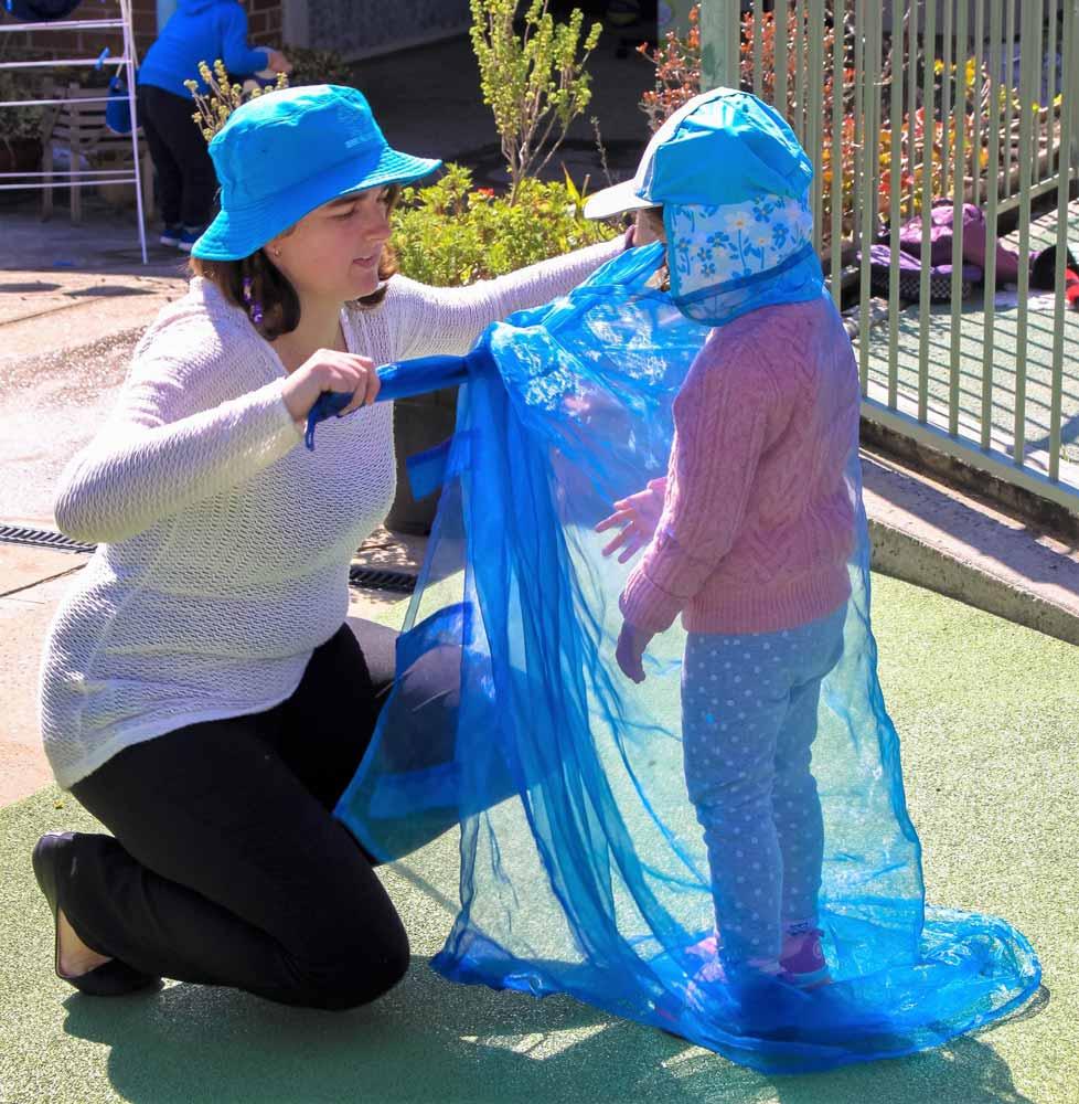 Beverly Montessori teacher with child