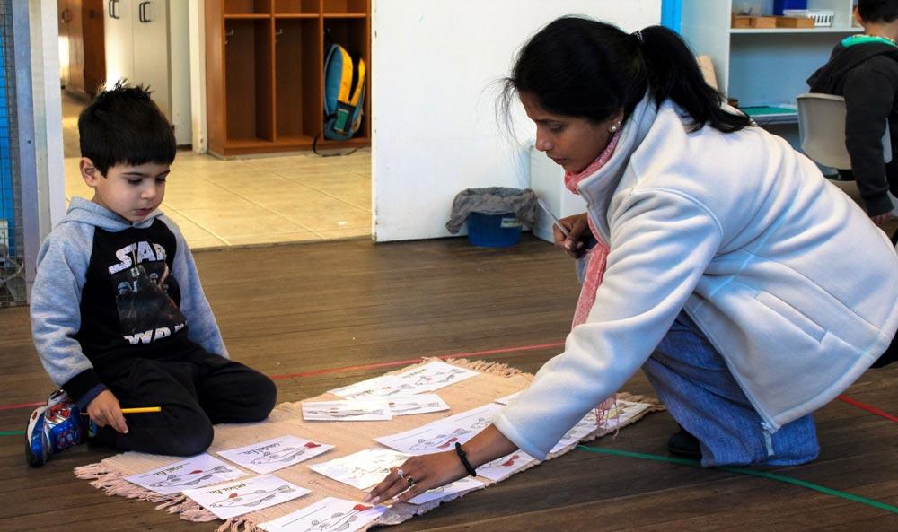 Beverly Montessori kid with teacher