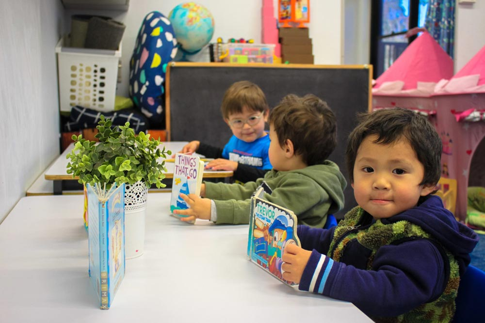 Kids reading at Beverly Montessori