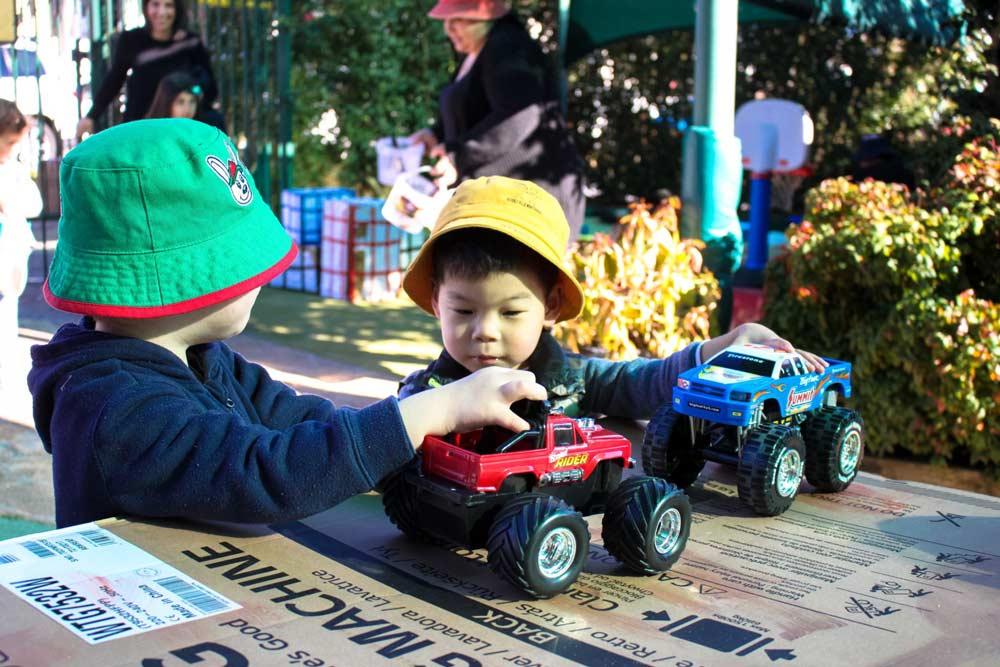 Beverly Montessori kids with toy trucks