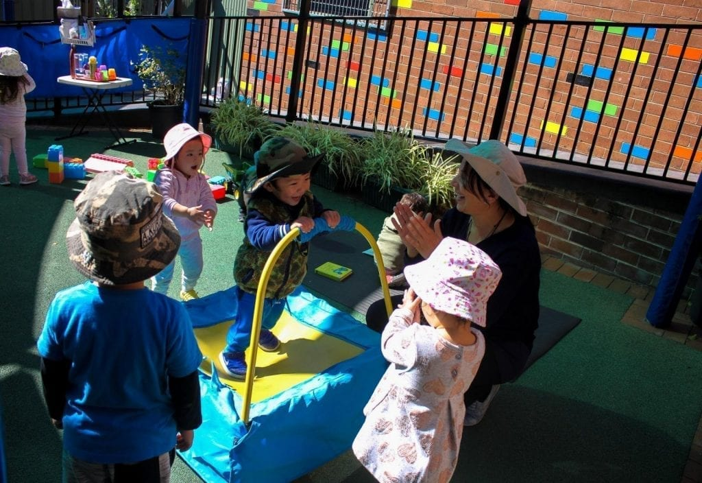 Beverly Hills Montessori Children Playing with Teacher
